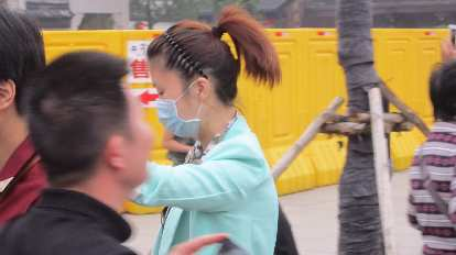 A young lady wearing a mask in Nanjing.