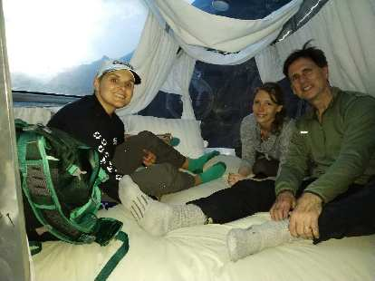 Mel, Teresa, and Matthew in the sleeping area of the pod.