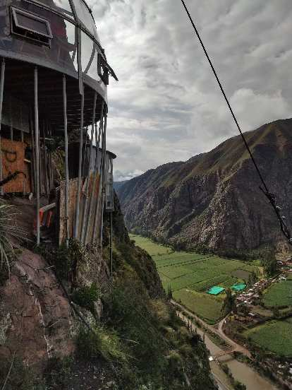 The stilts holding up the dining pod, with the Sacred Valley below.