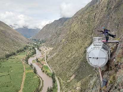 Two of the other Americans on top of their pod with the Sacred Valley below.