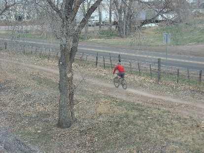 Lone mountain biker on a flat stretch.