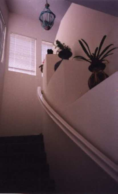 Perhaps the most beautiful feature is the curving stairway leading from the foyer.