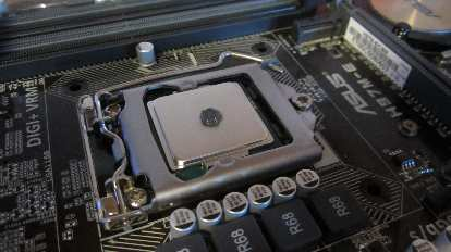 Applying a pea-sized bit of IC Diamond thermal paste to the CPU, just as IC Diamond's website instructed.