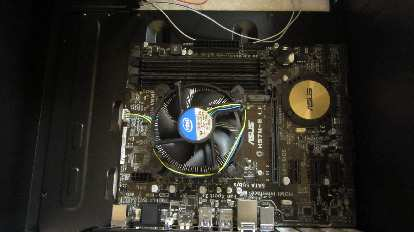The CPU and fan installed on the motherboard, which in turn is installed in the case.