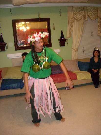 Thavrin begins his hula dance.