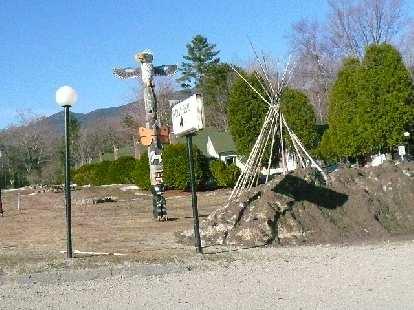 A totem pole and teepee frame.