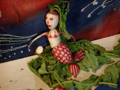 A mermaid radish carving.