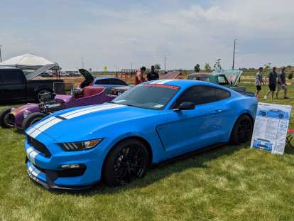 A bright blue Ford Mustang Shelby GT350.