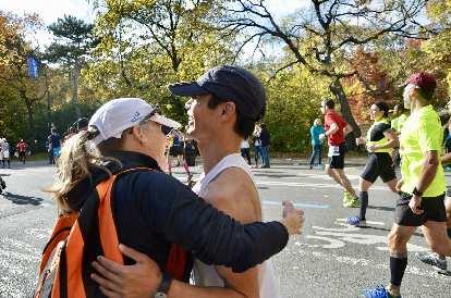 [Mile 24.2] Bev Benzon, an old friend from the Tri-City Triathlon Club, giving Felix Wong a hug at the 2016 New York City Marathon.