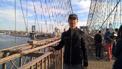 Felix Wong on the Brooklyn Bridge.