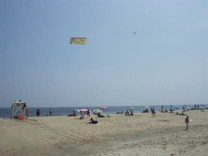 Amazingly, the beach at Sandy Hook was filled with... more commercialism.  Many planes would fly on by with banners advertising stuff to the sunbathers.
