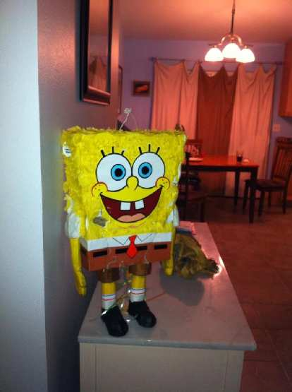 SpongeBob greets Alene when she gets back from Arizona. Her husband had relieved him of his motorist greeter duties.