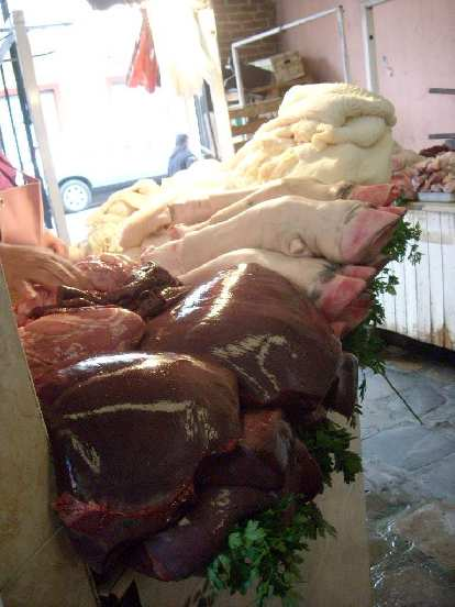 This market had vendors selling huge slabs of bull liver, hooves, and tribe (intestines).