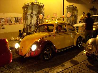 A pimped-out Volkswagen Beetle in a parade near the Z