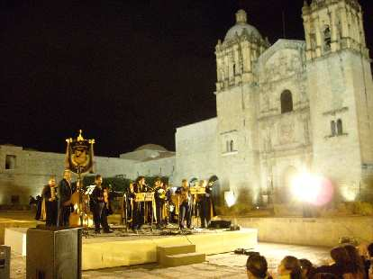 An older choir sang Christmas Carols at La Iglesia de Santo Domingo.