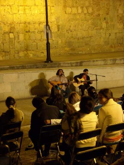 Two guys on acoustic guitars outside the Instituto de Artes Graficas in Oaxaca de Juarez.