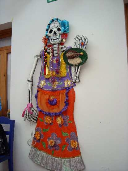 Skeleton art on the wall of the dining room in La Casa de Sabores.