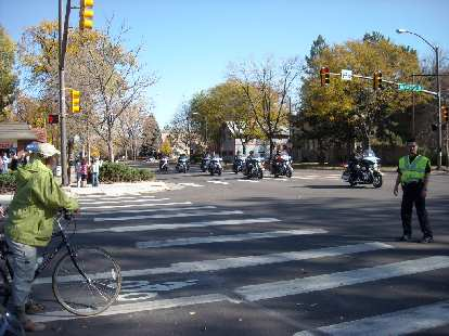I was biking over to CSU but encountered a police blockade here at Mulberry St.  This is because the Obama motorcade was coming through.