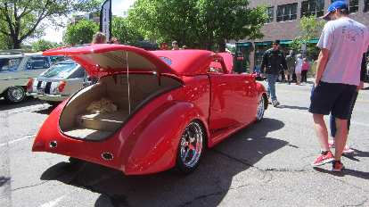 red chopped hot rod coupe with suicide doors
