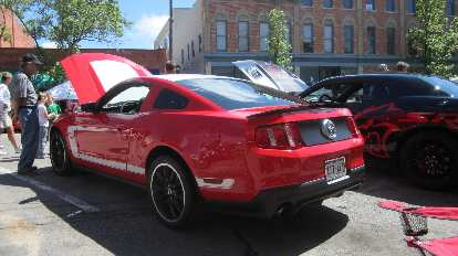 red 2014 Ford Mustang Boss 302 with white stripe