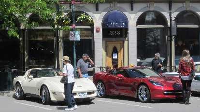 white 1970s era Corvette Coupe with dark red 2015 Corvette Stingray