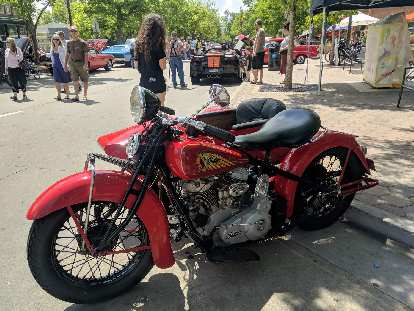 A vintage Indian motorcycle with sidecar.