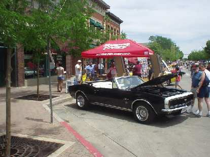A nicely restored Camaro convertible from the late 60s.