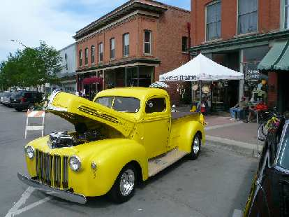A yellow pickup truck -- a Dodge, I think.