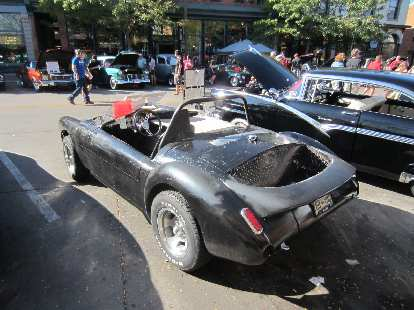 """A """"recycled"""" jalopy made from various parts.  You can see the MGA fenders."""