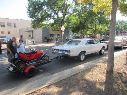 A Chevrolet Chevelle towing a pedal car.