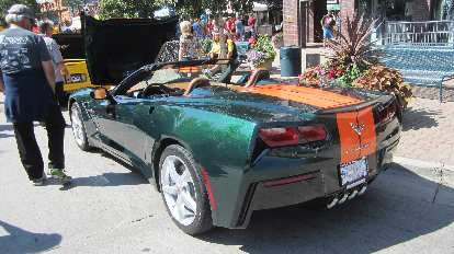 Green C7 Corvette convertible with orange stripes. This was Maureen's favorite.