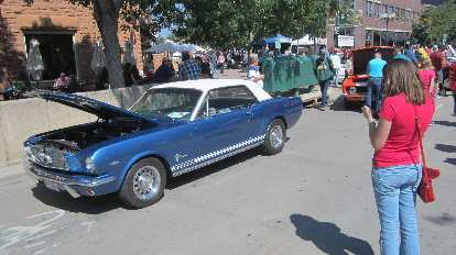 Maureen texting her mom about whether she had a Mustang like this '65. Turns out her mom had a white '66 with a blue interior.