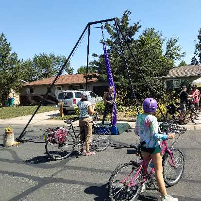 An aerial silk demonstration off Ponderosa Drive during Open Streets in Fort Collins.