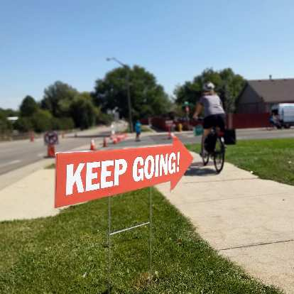 """""""Keep going!"""" direction arrow along the Open Streets route."""