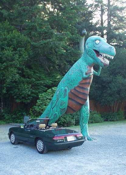 [Prehistoric Gardens, north of Ophir, OR] Rah! Elaina meets a Tyrannosaurus Rex.