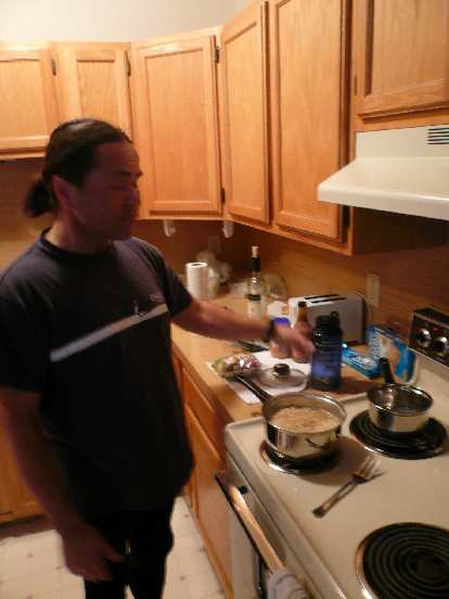 Danny creating a delicious entre for dinner in our condo.