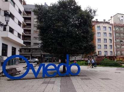 Blue Oviedo sign at Plaza Carbayón in central Oviedo.