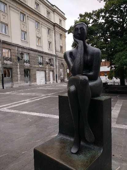 """The Thinker"" (La Pensadora) sculpture, located near a theater in central Oviedo."
