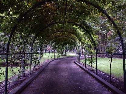 Arched walkway through the Campo de San Franciso in central Oviedo.