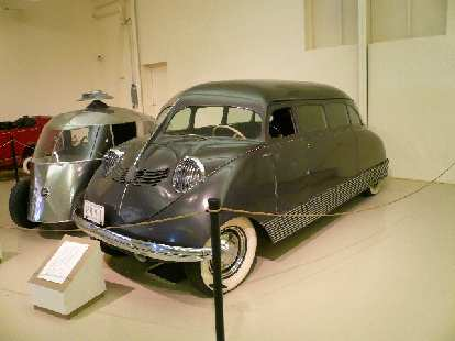 The 1935 Stout Scarab had a rear Ford V-8 producing 200 hp.  Only nine were built.