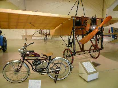The 1946 Whizzer Motorbike got 125 mpg with 2.5 hp.  Louis Bleriot and his 1909 Bleriot XI made the first aeroplane flight across the English Channel.
