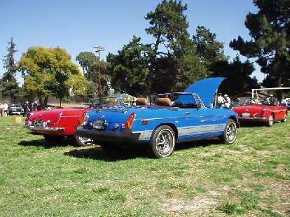 MGBs.  The blue one is a later rubber-bumper type.