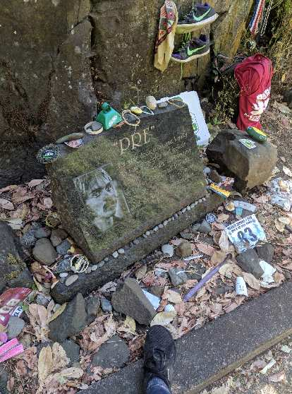 My foot at Pre's Rock, where people pay tribute to Steve Prefontaine even 44 years after his death.