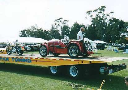 MG Midget on a trailer with a British motorcycle.