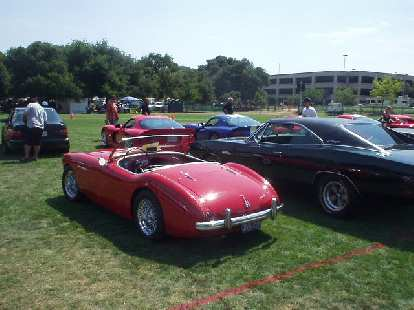 The Austin Healey is fairly large for a British sports car, but looks rather small next to a Dodge Charger.