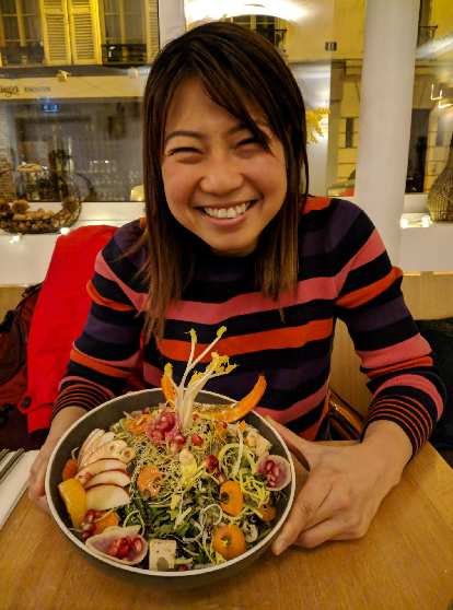 Angie with a salad at Le Potager de Charlotte, a highly rated vegan restaurant in Paris.