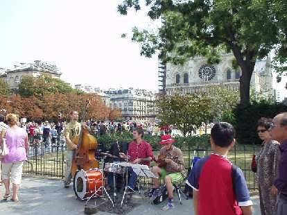 There was a cheery band playing on the sidewalk right in front of the Notre Dame.