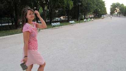 Katia walking in a park near the Eiffel tower.