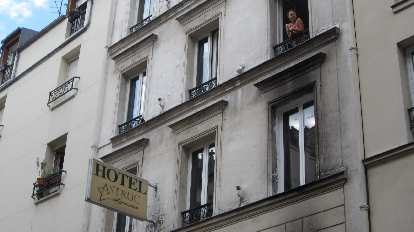 Katia in the window of Hotel Astruc, our home base in Paris.