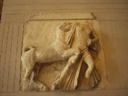 [Louvre] This is one of the fragments of la Frise des Panathenees, which decorated the exterior of the greatest Athenian temple, the Parthenon, in 440 B.C. In this fragment, a half-main/half-horse creature is